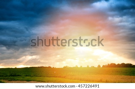 Dramatic sunset over fields