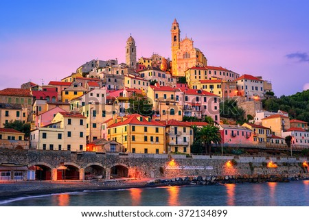 Dramatic sunset over medieval town Cervo on italian Riviera, Liguria, Italy