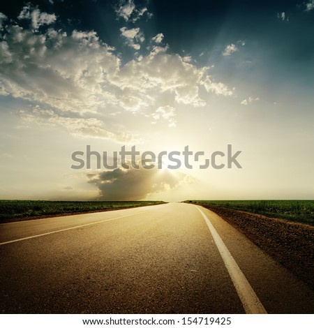 dramatic sunset over road to horison - stock photo