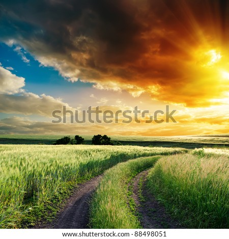 dramatic sunset over road to horizon - stock photo
