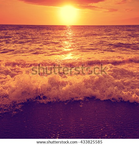 Dramatic sunset over sea and beach. - stock photo