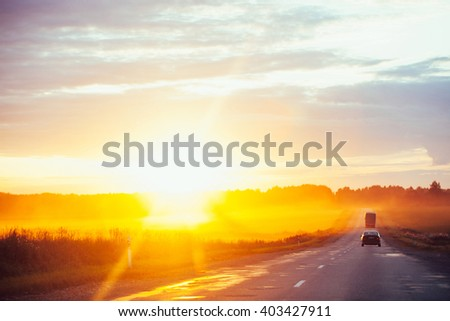 Dramatic sunset over the road - stock photo
