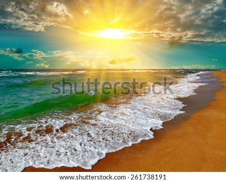 Dramatic sunset over the sea in the tropics - stock photo