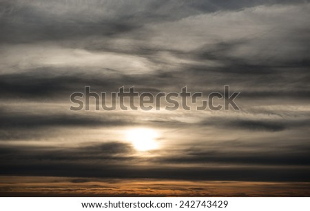 dramatic sunset photo with dark clouds - stock photo
