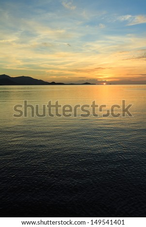 dramatic sunset sky and tropical sea at dusk - stock photo