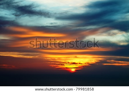 Dramatic sunset sky as a beautiful background - stock photo