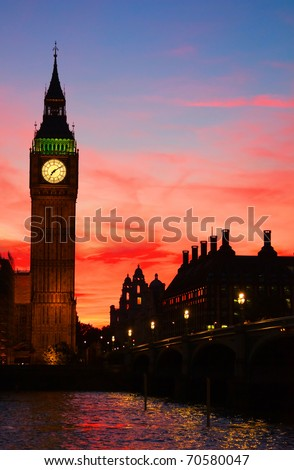 Dramatic sunset sky over Famous Big Ben clock tower in London, UK. - stock photo