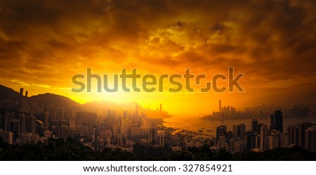Dramatic sunset sky over Hong Kong panoramic view - stock photo
