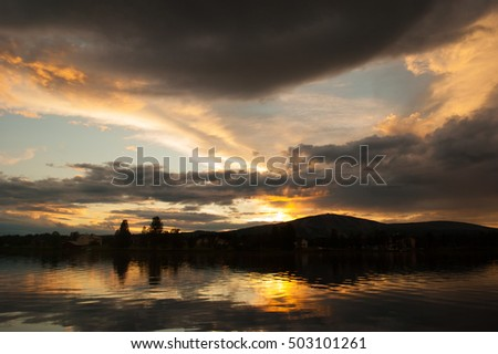 Dramatic sunset sky over the lake