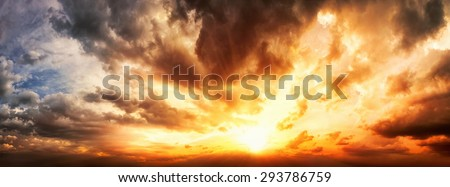 Dramatic sunset sky panorama with the clouds glowing in vivid warm colors - stock photo