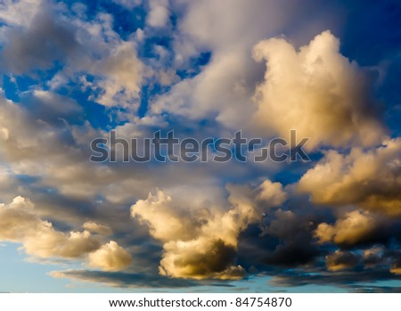 Dramatic sunset with light and heavy clouds - stock photo