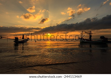 Dramatic Sunset with local boat in Samui, Thailand - stock photo