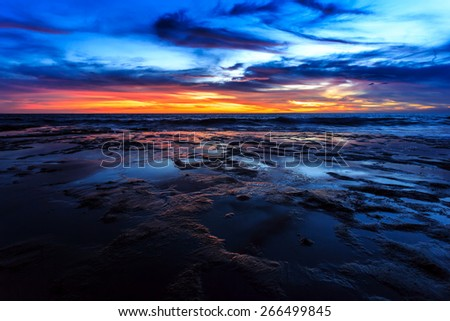 Dramatic Sunset with reflection in Bali, Indonesia - stock photo