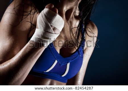Dramatic toned fit female - stock photo