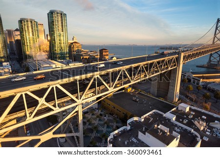 Dramatic, unusual wide-angle perspective from just above the western approach to the San Francisco-Oakland Bay Bridge on a brilliant summer morning