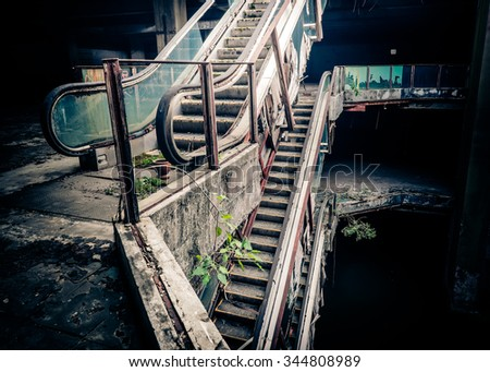Dramatic view of damaged escalators in abandoned building. Apocalyptic and evil concept - stock photo