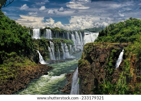 Dramatic view of Iguazu waterfalls in Argentina with stormy clouds in the background          - stock photo