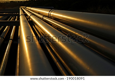 dramatic view of steel pipes in oil refinery - stock photo