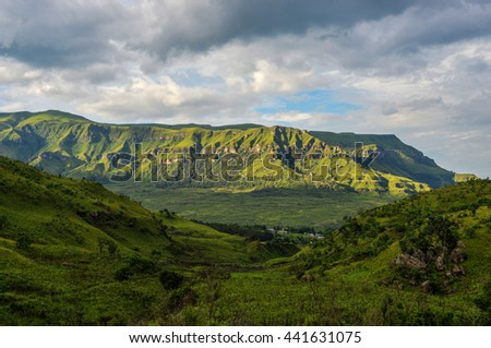 Dramatic view of the hills of the Drakensberg Range in the Giants Castle Game Reserve, KwaZulu-Natal, South Africa. - stock photo