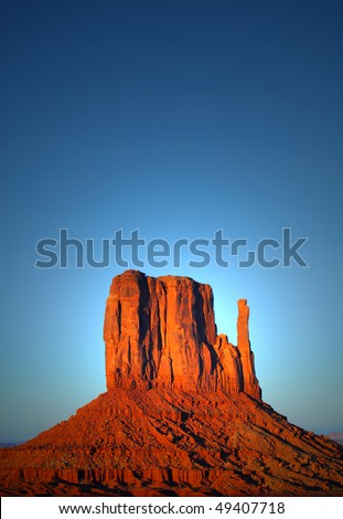 "Dramatic view of the ""Mitten"" in the Navajo park Monument Valley at sunset - stock photo"
