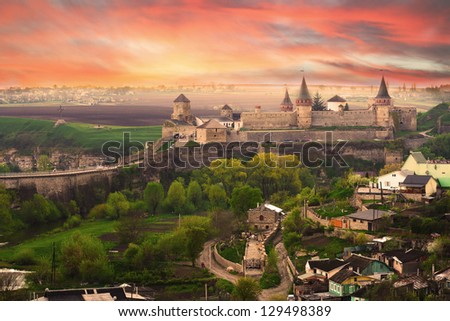 Dramatic view on the castle in Kamianets-Podilskyi in spring. Ukraine - stock photo