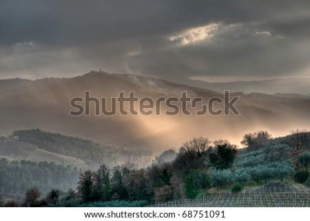 Dramatic winter evening light on an Italian landscape - stock photo