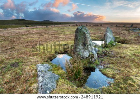 Dramatic winter sunrise over standing stones at Stannon stone circle on Bodmin Moor in Cornwall