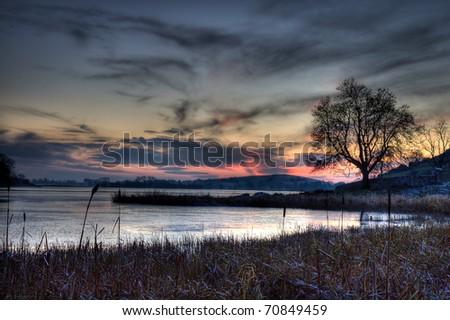 Dramatic winter sunset in Lough Gur, Ireland. - stock photo