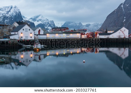 Dramatic winter weather in the picturesque fishing hamlet of Hamnoy, Lofoten Islands, Norway - stock photo