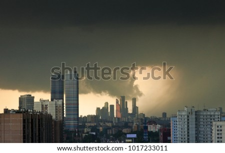Dramatic yellow sky with dark clouds over Moscow during the beginning of a strong hurricane