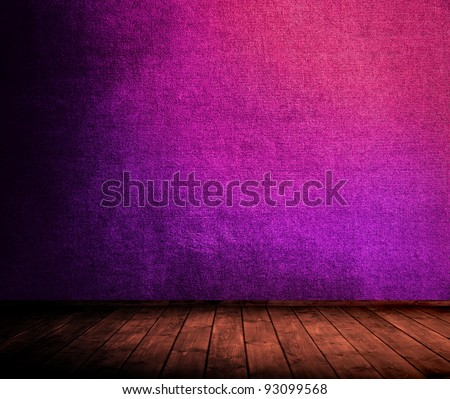 dramatically lighted grunge interior used as background. - stock photo