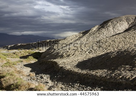 Dramatically lit Land Forms in Death Valley, California, USA - stock photo