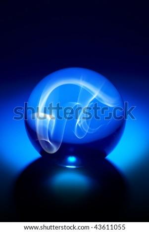 Dramatically shot crystal ball with smokey effect - stock photo
