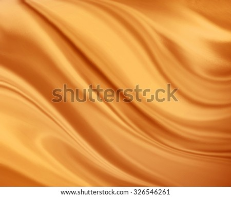 draped folds in material background design, warm orange gold color, satin or silk smooth texture in curving wrinkles and creases, luxury background - stock photo