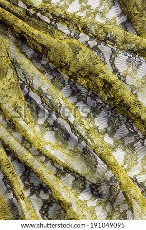 Draped yellow lace as a background - stock photo