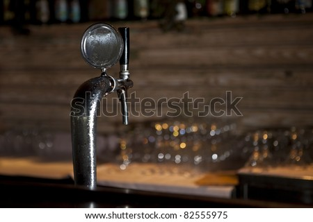 Draught Beer Tap in a Bar - stock photo