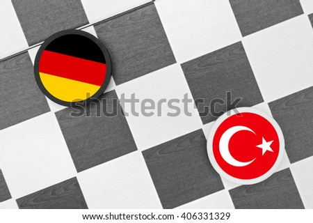 Draughts (Checkers) - Germany vs Turkey. Conflict between states (refugee crisis, free speech issue, membership in EU)  - stock photo