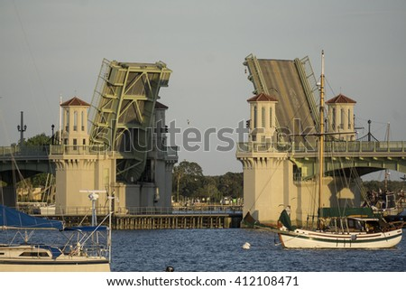 Draw bridge opening/Draw Bridge at Saint Augustine Florida/Evening traffic is halted as a vessel travels under the drawbridge - stock photo