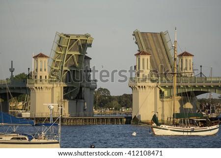 Draw bridge opening/Draw Bridge at Saint Augustine Florida/Evening traffic is halted as a vessel travels under the drawbridge - stock photo