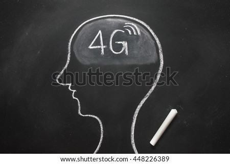 Draw the shape of a human head on the blackboard ( 4g in the brain ) - stock photo