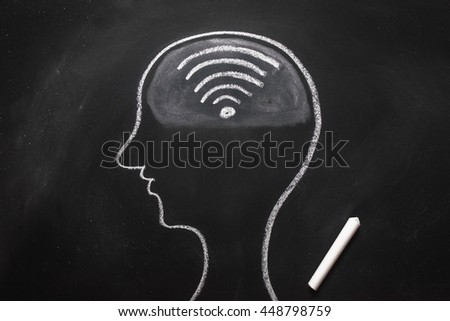 Draw the shape of a human head on the blackboard ( wifi in the brain ) - stock photo