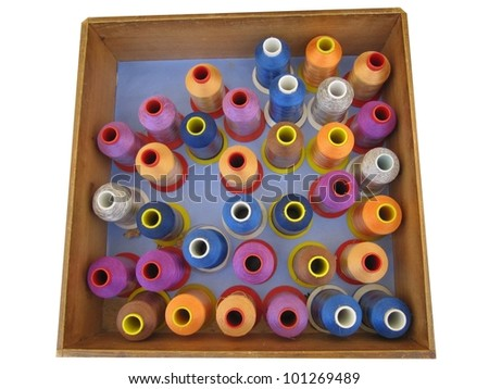 Drawer with silk thread spools - stock photo