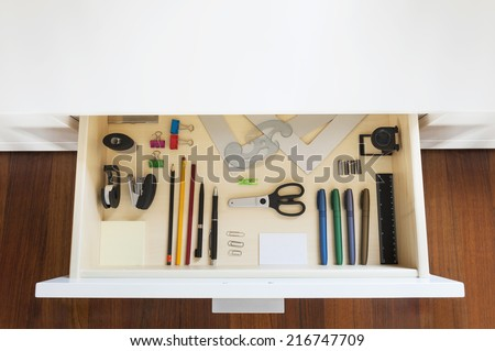 drawer with tools and accessories for drawing and office - stock photo