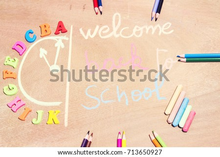 Drawing clock writing welcome back school stock photo edit now drawing a clock and writing welcome back to school with chalk colorful pencil and letter thecheapjerseys Images