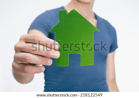 drawing a picture in his hand house - stock photo