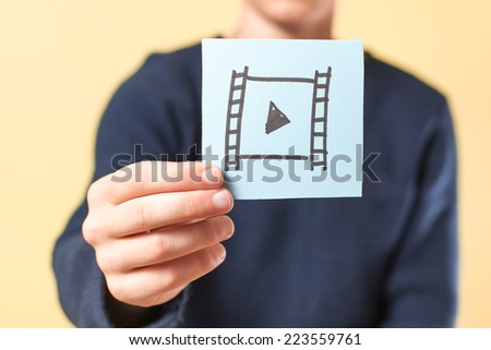 drawing a picture in his hand play - stock photo