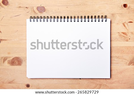 drawing block with copy space on wood table - stock photo