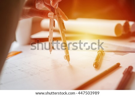 Drawing blueprints with a compass divider - stock photo