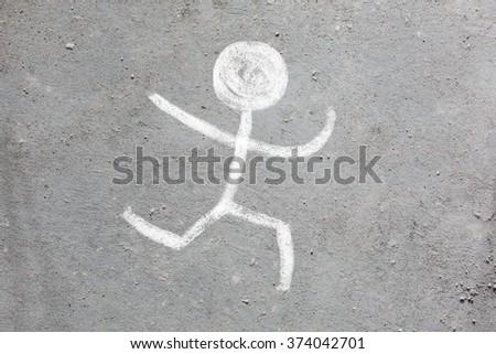 Drawing chalk man - stock photo