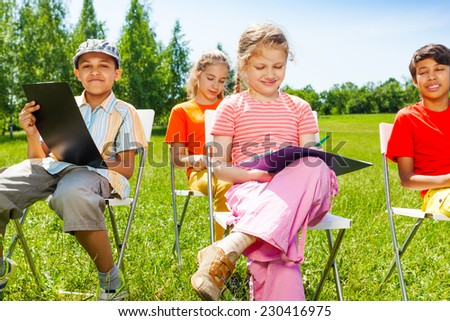 Drawing children sit on white chairs outside in summer